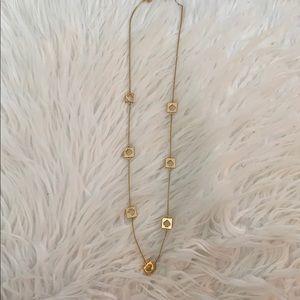 Gold Kate Spade logo long necklace